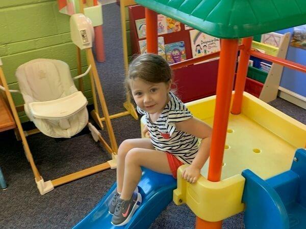Little Girl playing inside childrens church room
